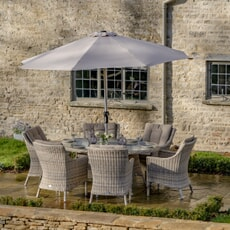 Bramblecrest Ascot 175 x 120cm Elliptical Table with 6 Armchairs and Parasol