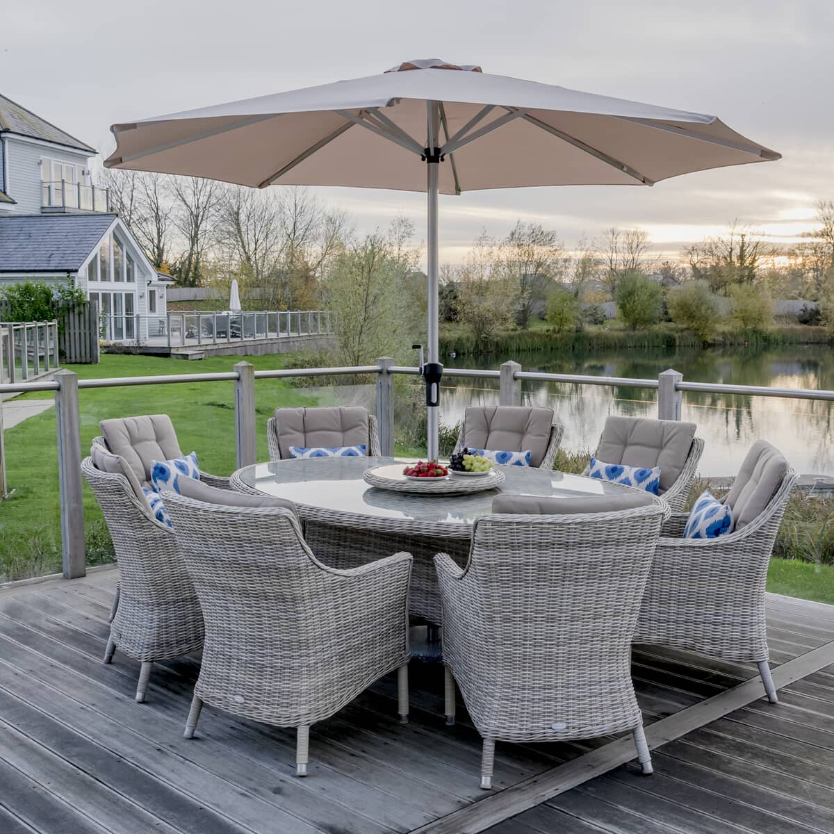 Bramblecrest ascot 220 x 145cm elliptical table with 8 armchairs with lazy and parasol