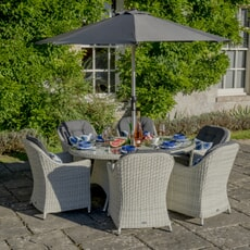 Bramblecrest Monterey 2019 175 x 120cm Elliptical Table with 6 Armchairs and Parasol
